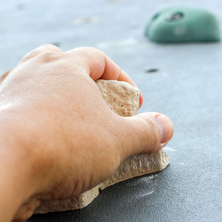 close up image of an indoor rock climbing grip