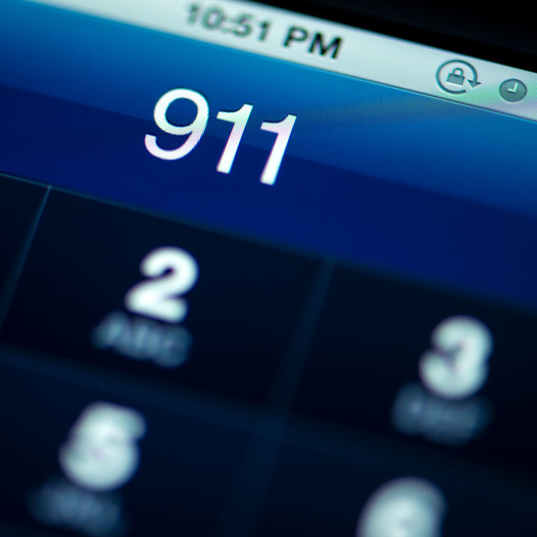 a smartphone screen with the numbers 911