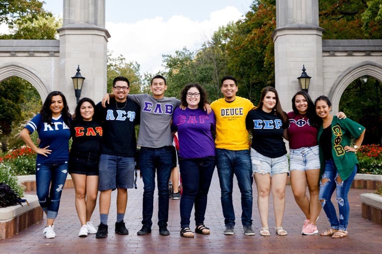 members of the multi-greek council standing in front of the sample gates