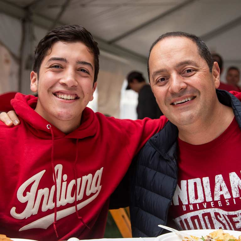 a father and son smiling, wearing Indiana University shirts